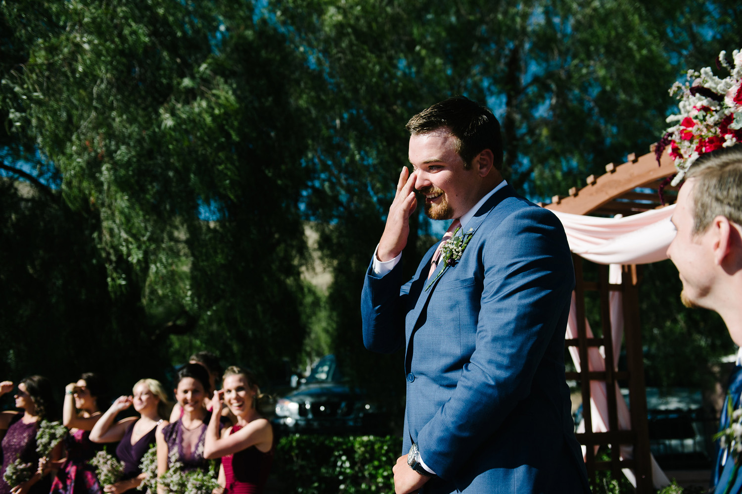 groom cries seeing bride wedding processional