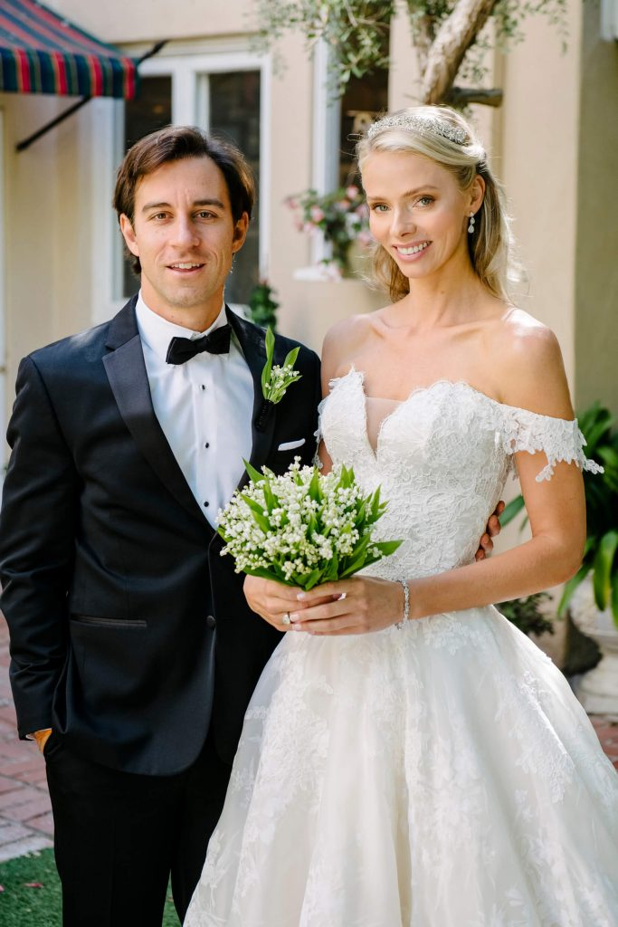 bride in monique lhuillier gown and lily of valley bouquet with groom in tuxedo at la jolla bed breakfast inn