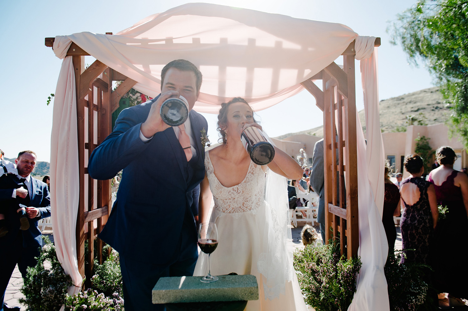 bride groom drink wine bottle ceremony high desert estate wedding