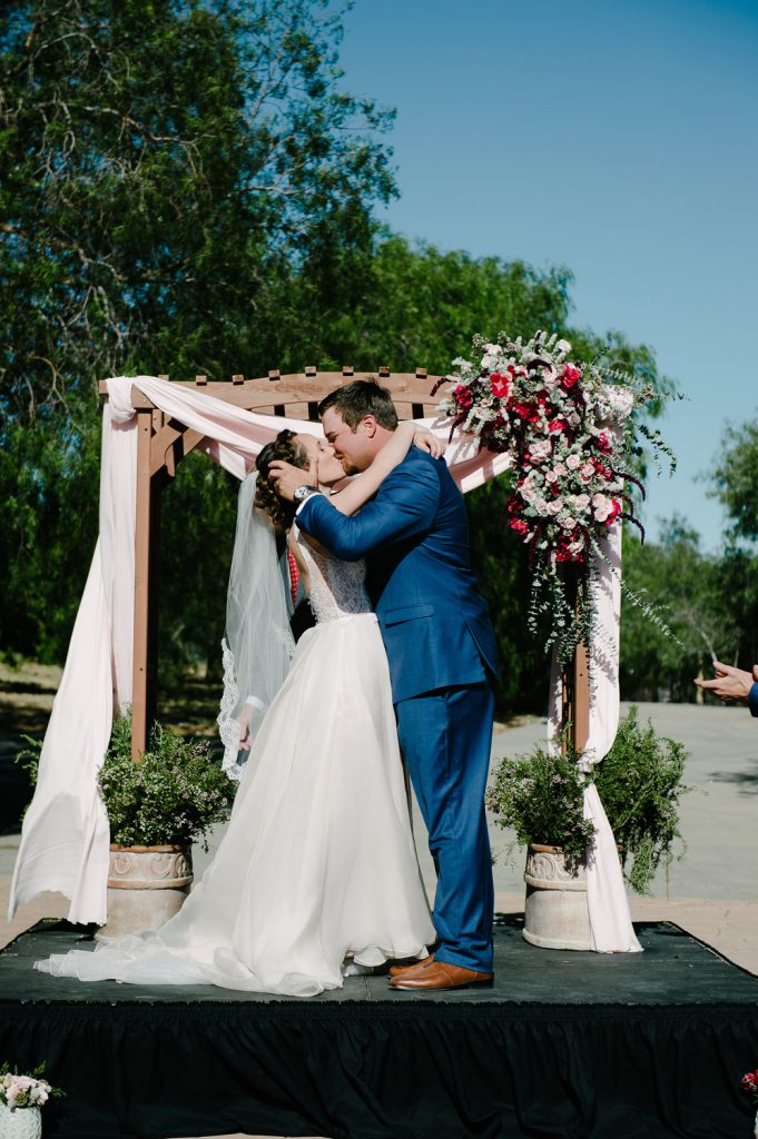 bride groom kiss high desert estate wedding