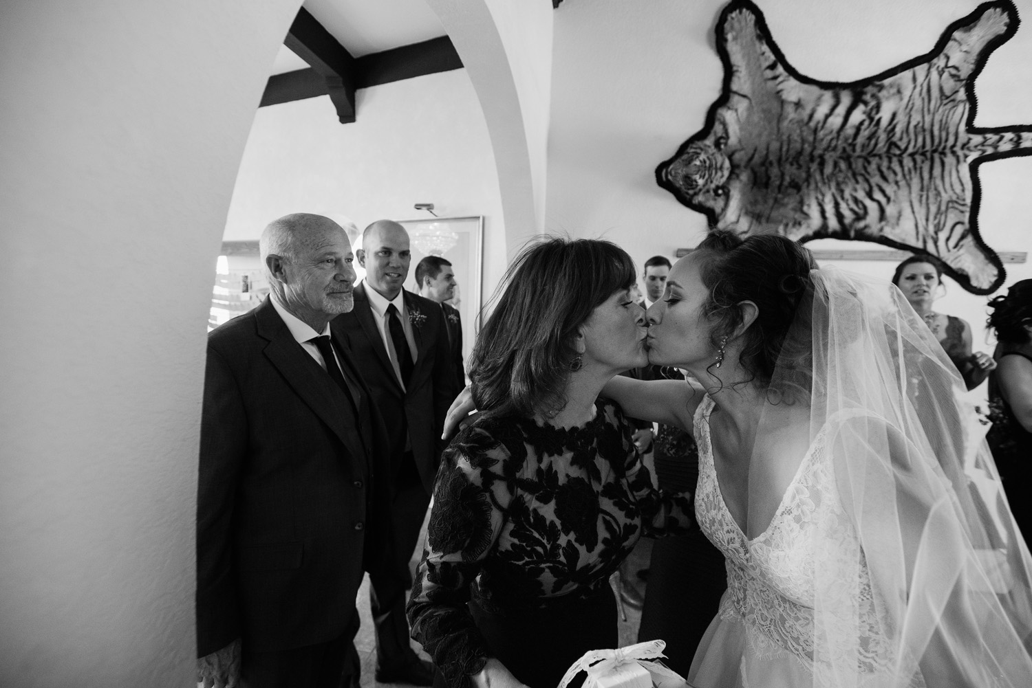 bride kisses mother in law after ceremony