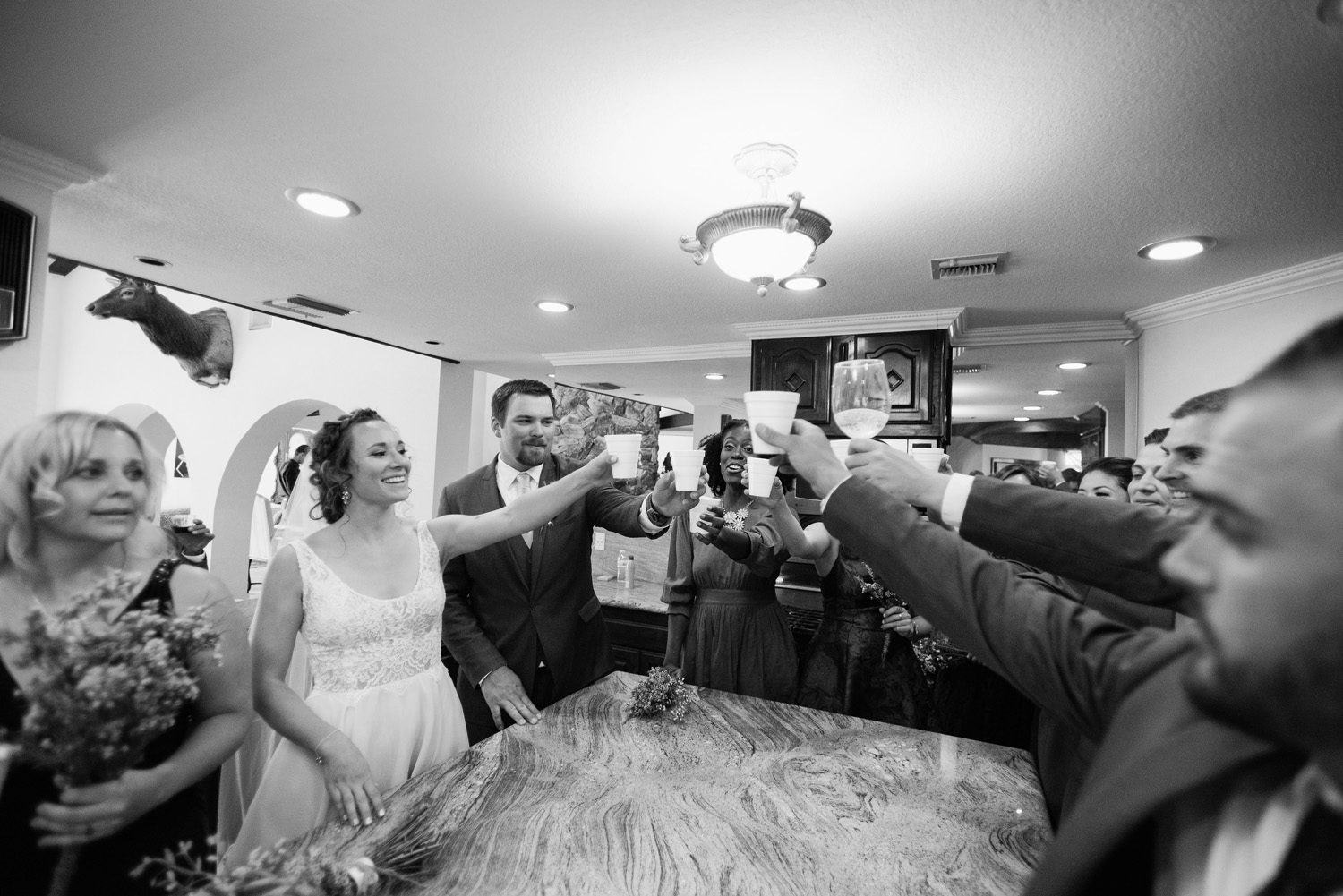 bride groom bridal party toast after high desert estate wedding