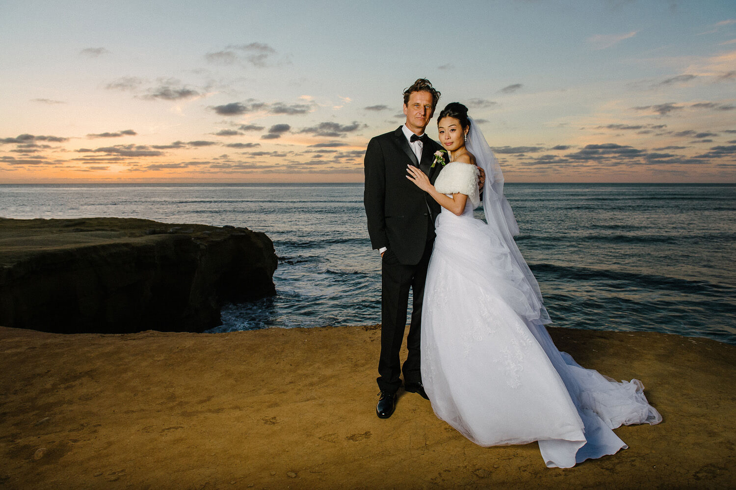 bride and groom portrait at sunset cliffs intimate elopement