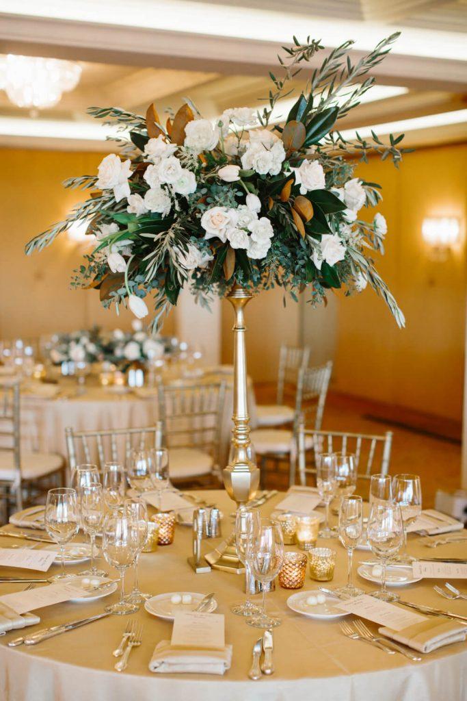 white mini roses tall vase textured table linen