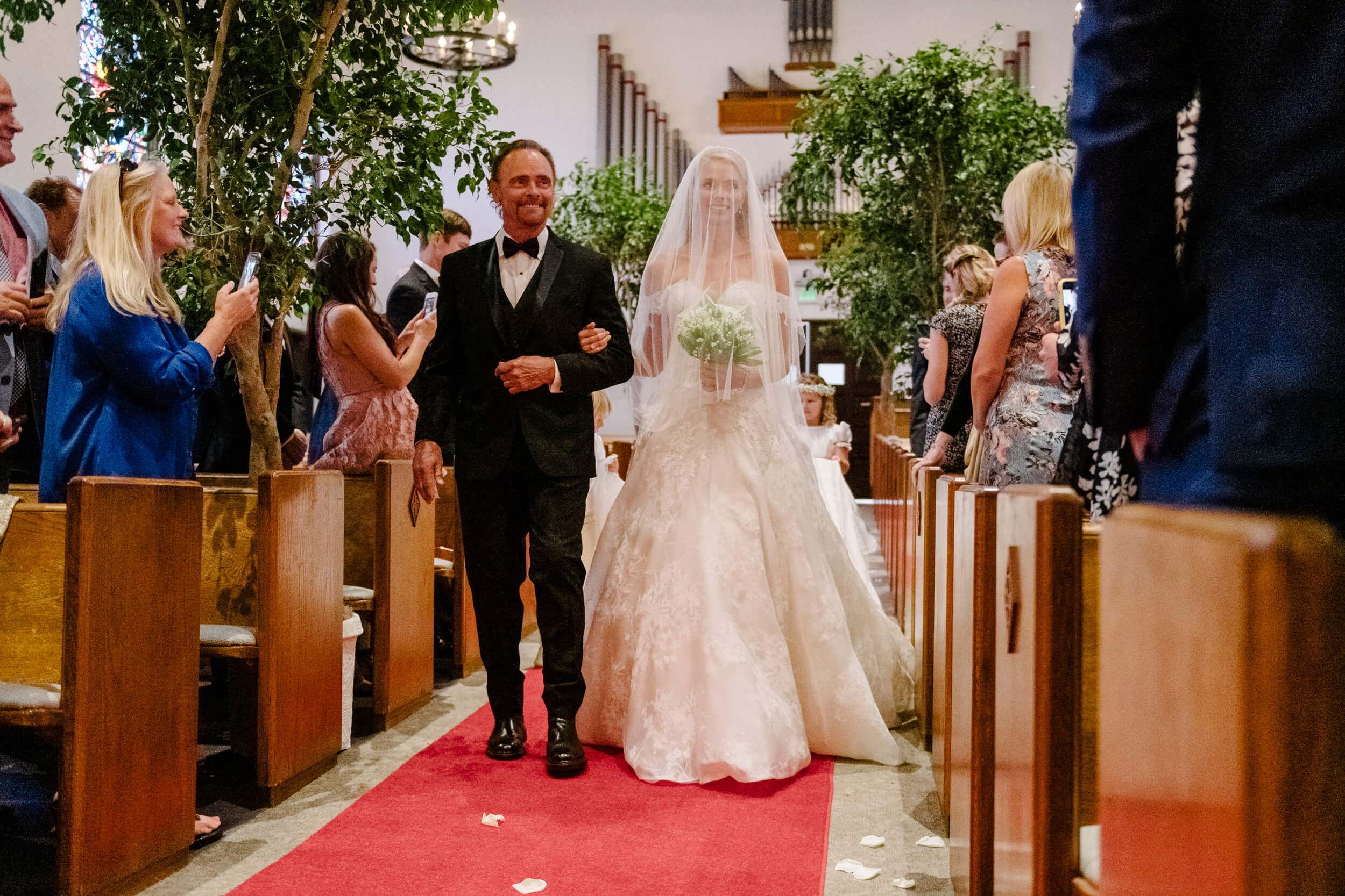 bride and father walk down aisle royal family inspired wedding