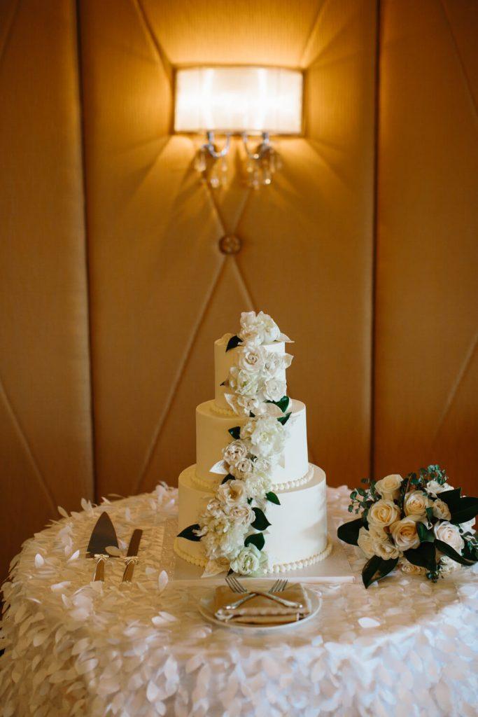 white three tier cake white flowers la valencia verandah room