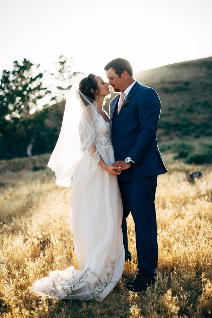 couple kiss field high desert estate wedding