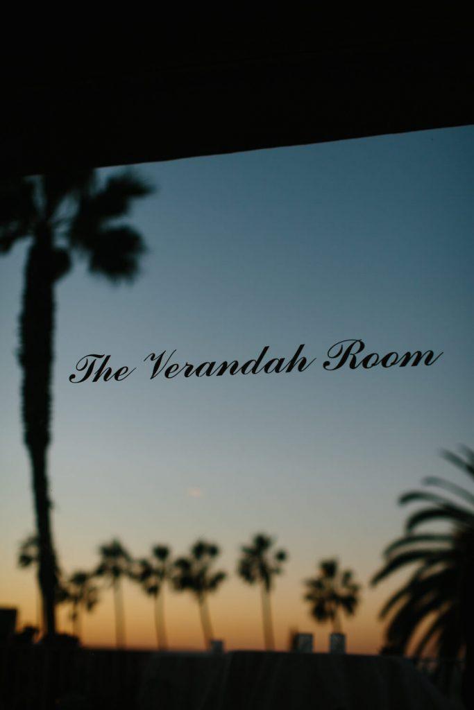 verandah room door sign sunset palm tree reflection