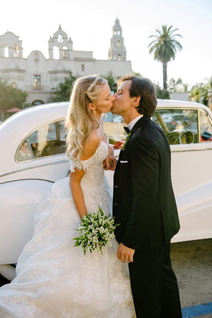 bride groom kiss near vintage rolls royce in balboa park