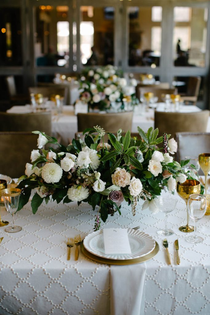 lisianthus peony greens french inspired floral arrangement centerpiece