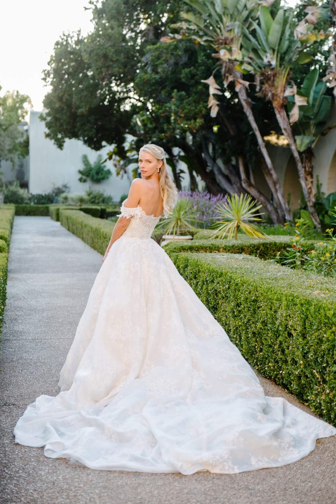 bride in monique lhuillier gown with long train at alcazar gardens in balboa park