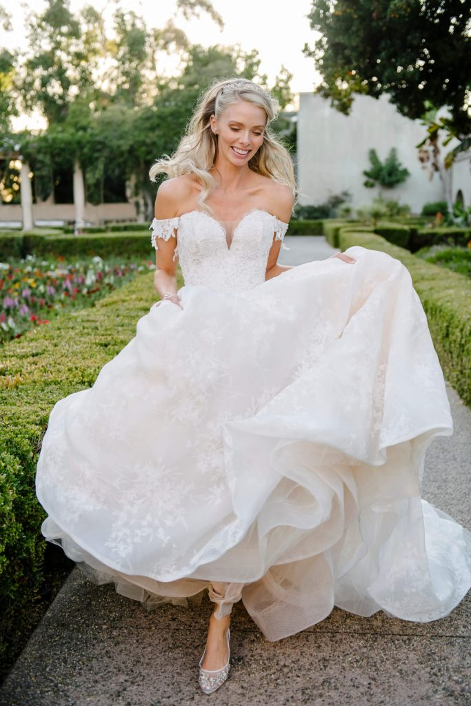 bride hops on path at alcazar gardens in balboa park
