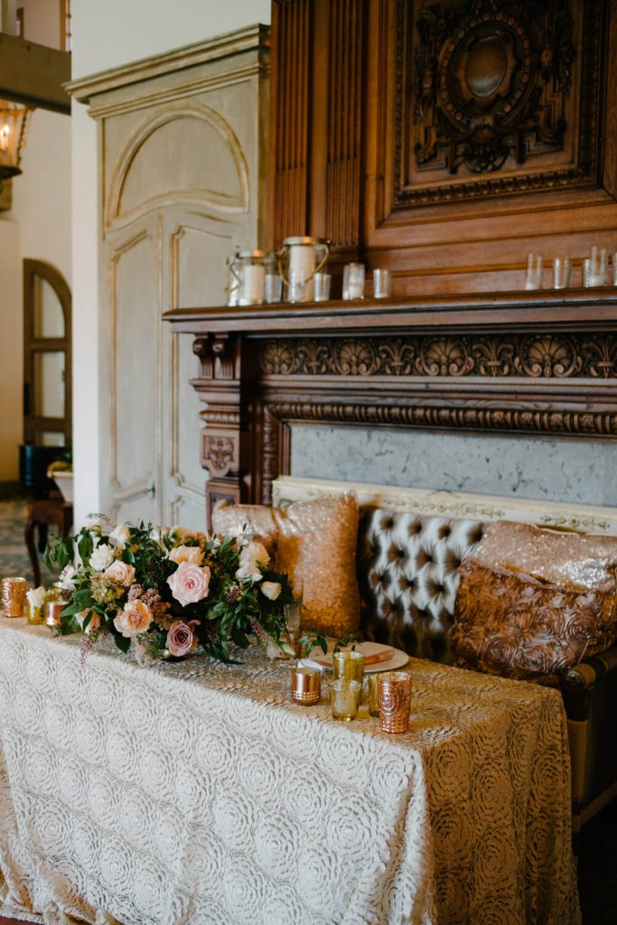french inspired sweetheart table copper candles luxury seating