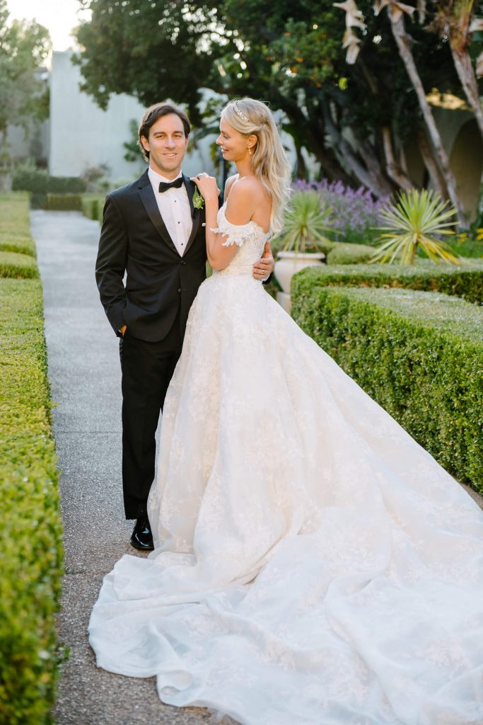 bride in monique lhuillier gown poses with groom alcazar gardens balboa park
