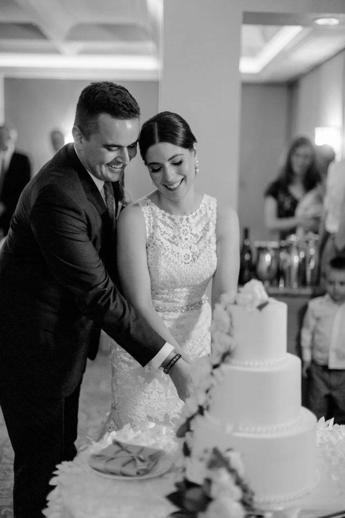 bride groom cake cutting la valencia hotel wedding reception verandah room