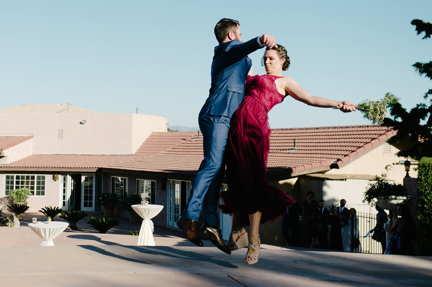 bridesmaid groomsman chest bump grand entrance high desert estate wedding