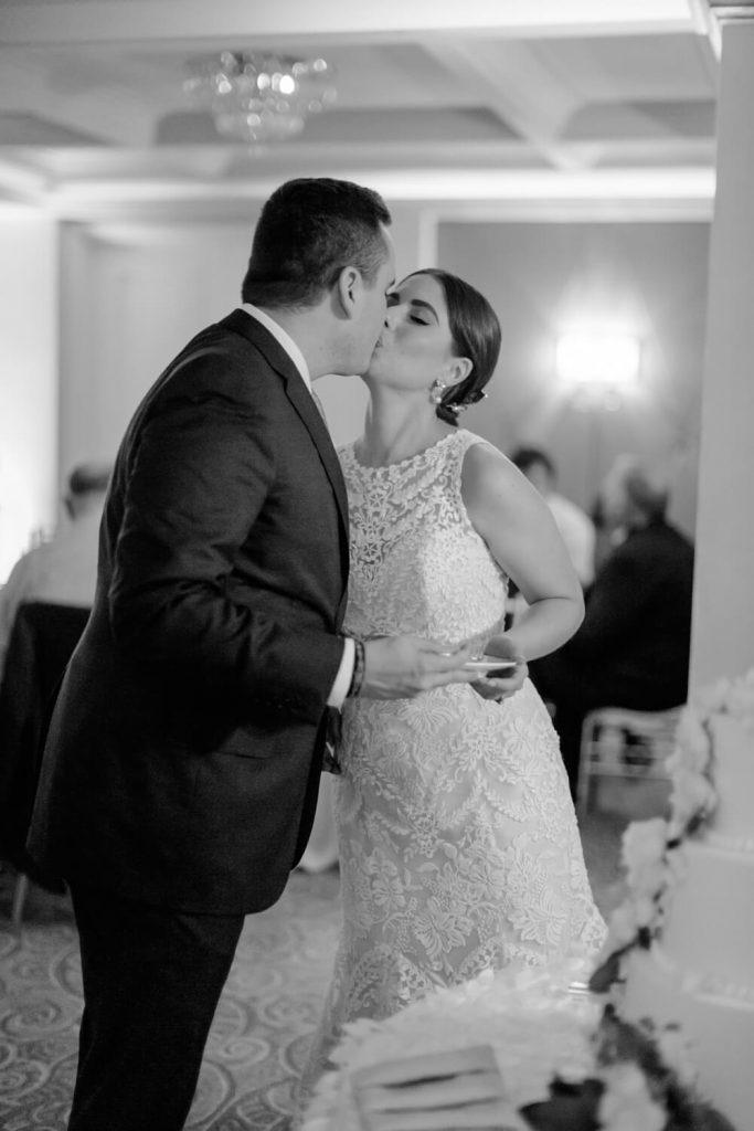 bride groom cake cutting kiss verandah room la valencia hotel wedding reception