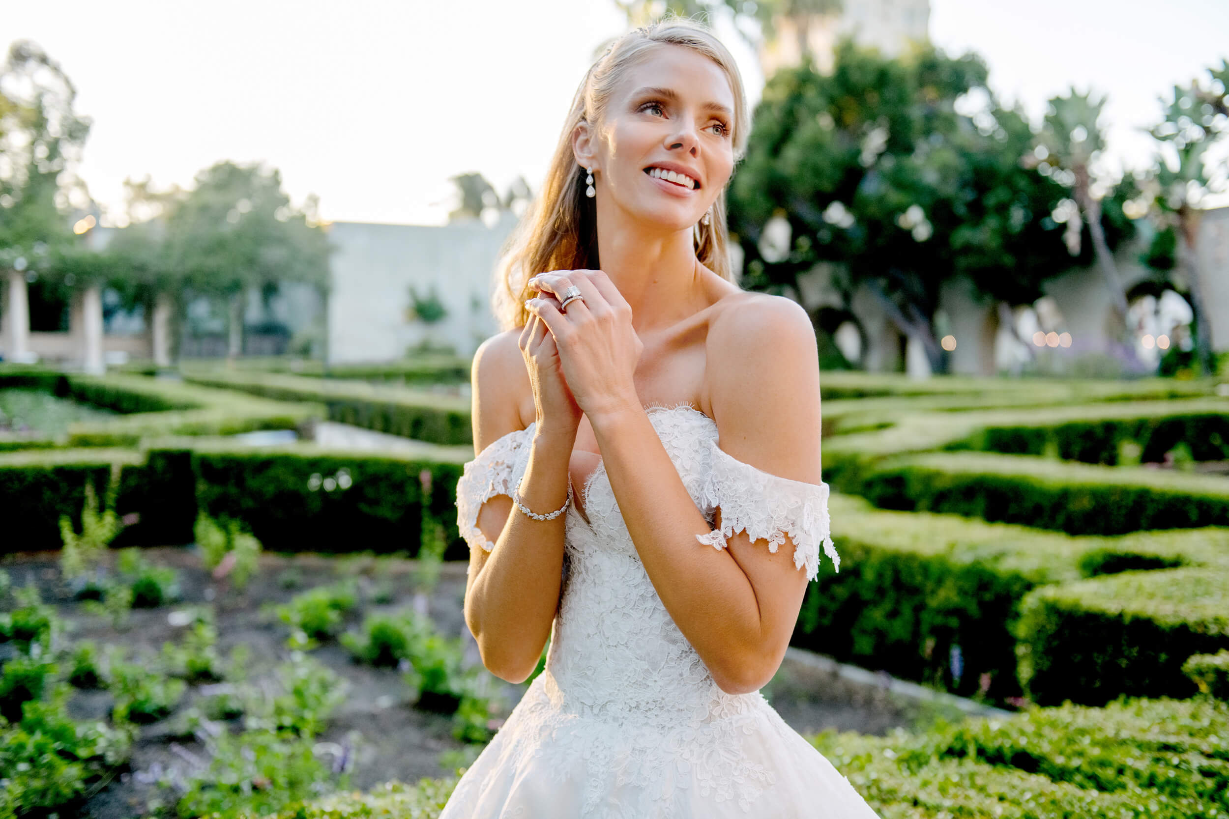 bride portrait in monique lhuillier gown at alcazar gardens balboa park