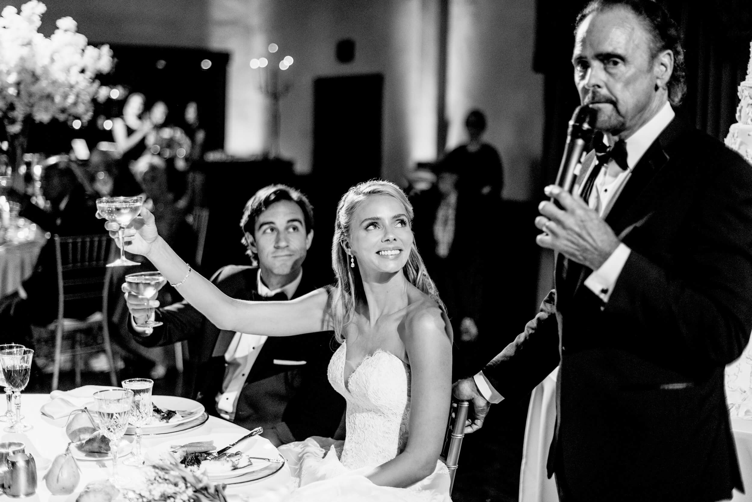 bride and groom toast father during speech royal family inspired wedding
