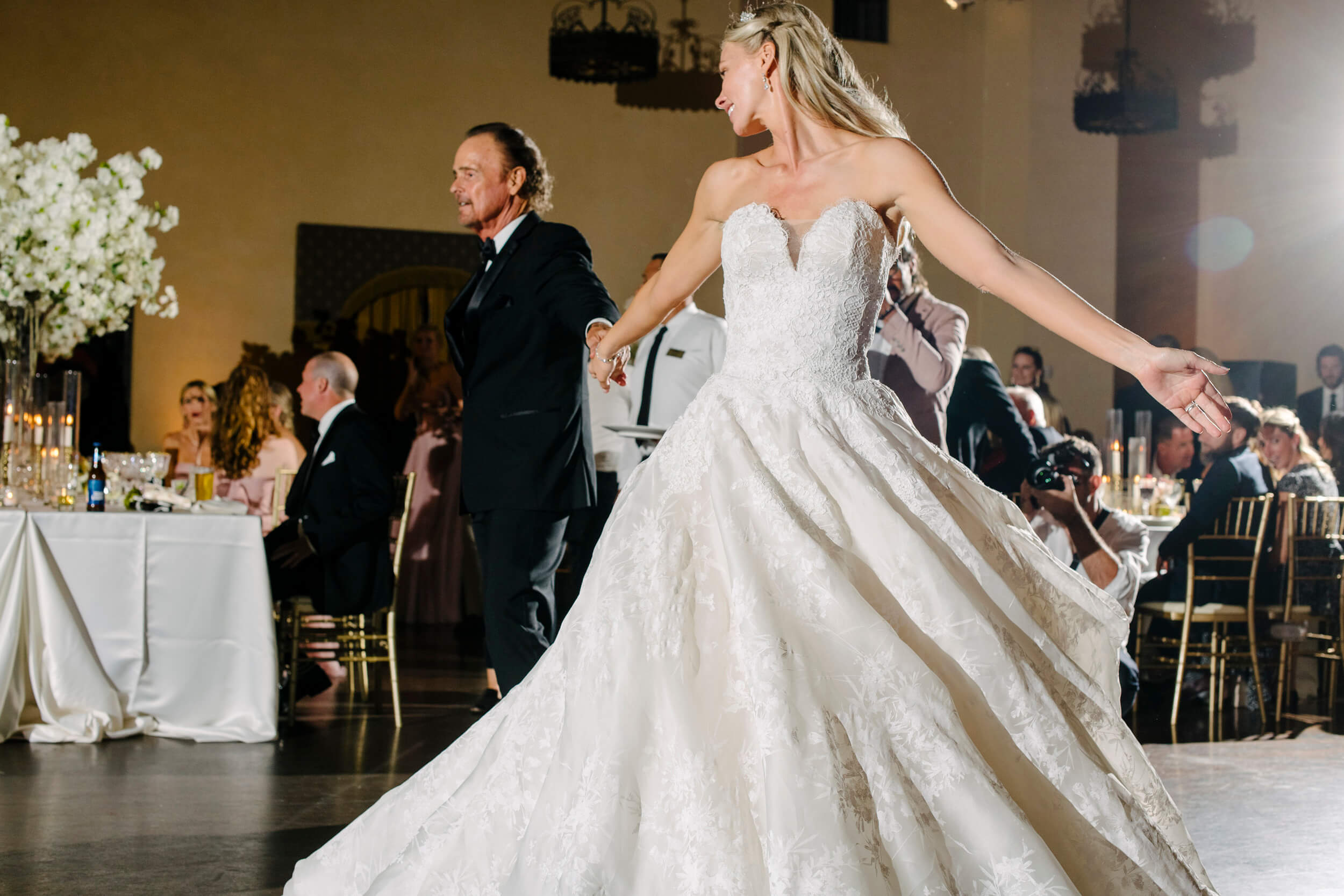 bride in monique lhuillier gown spins during father daughter dance royal family inspired wedding