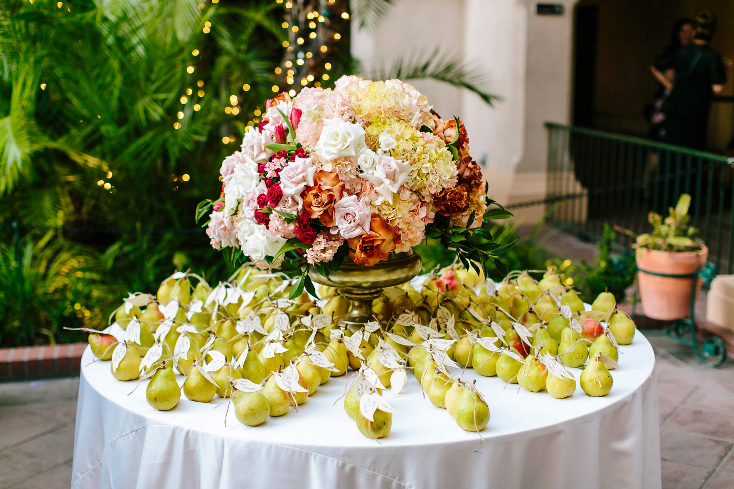 pears with table cards attached for royal family inspired wedding at the prado