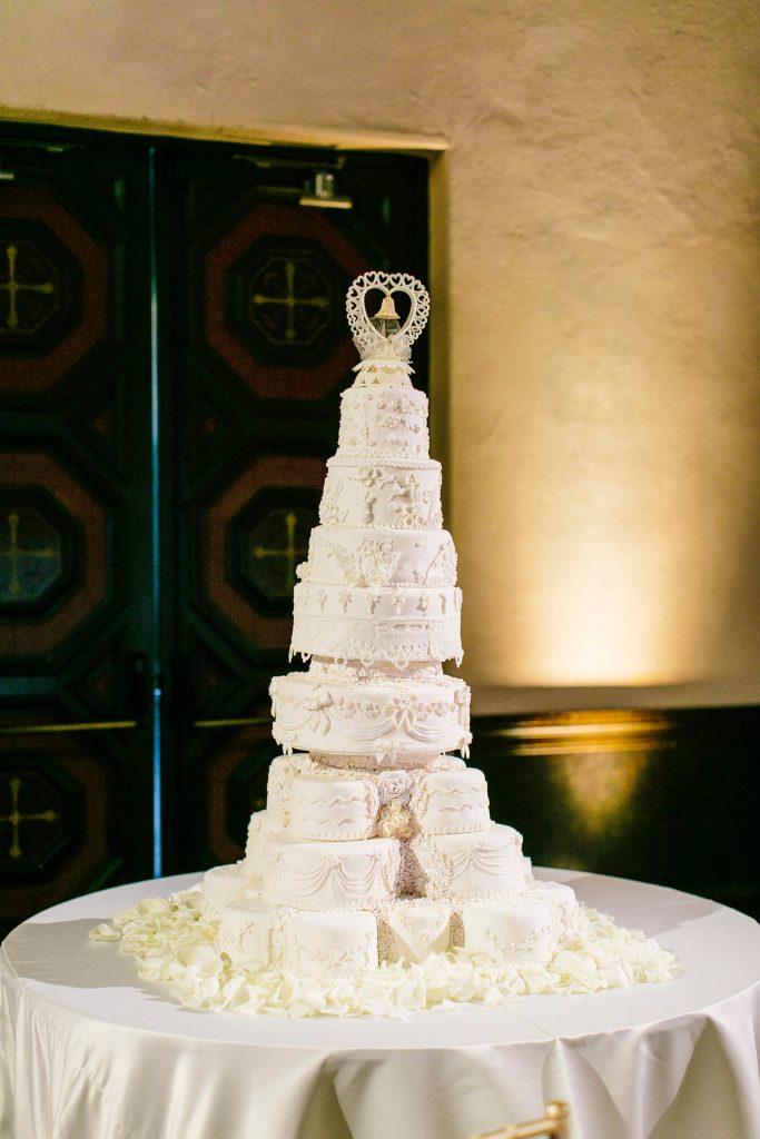 eight tier cake with heart bell topper royal family inspired wedding prado