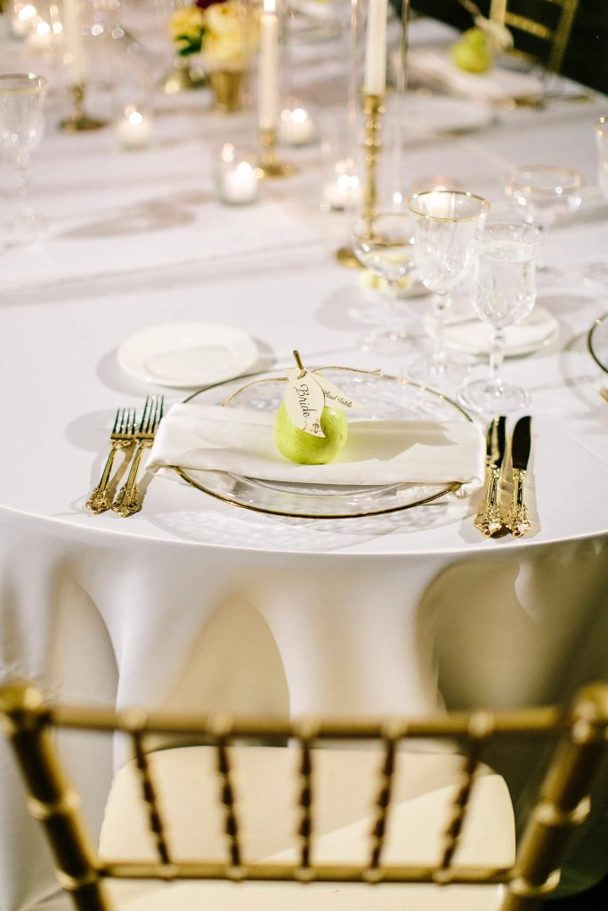pear escort card on place setting white linen gold flatware royal family inspired wedding prado balboa park