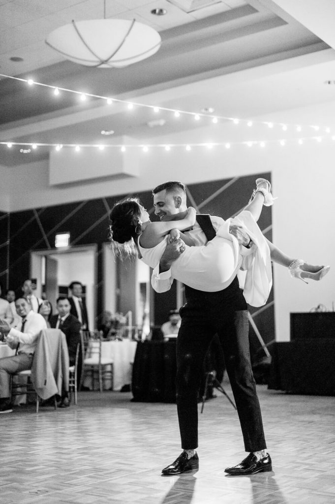 groom lifts bride off feet first dance dana mission bay