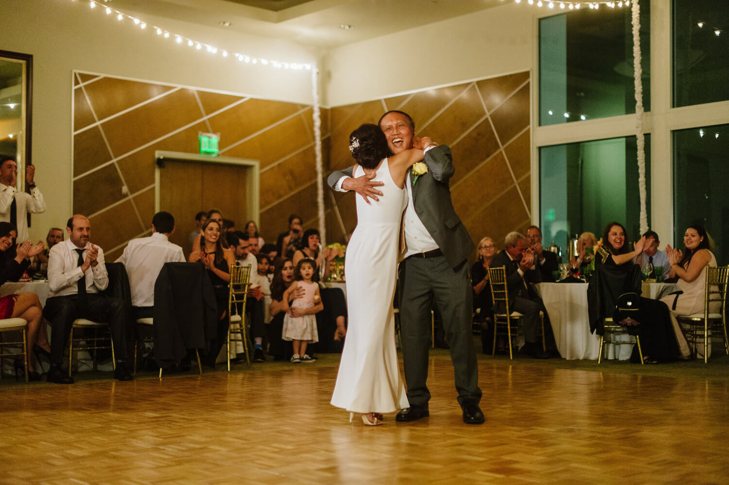 father and bride hug during dance at dana san diego