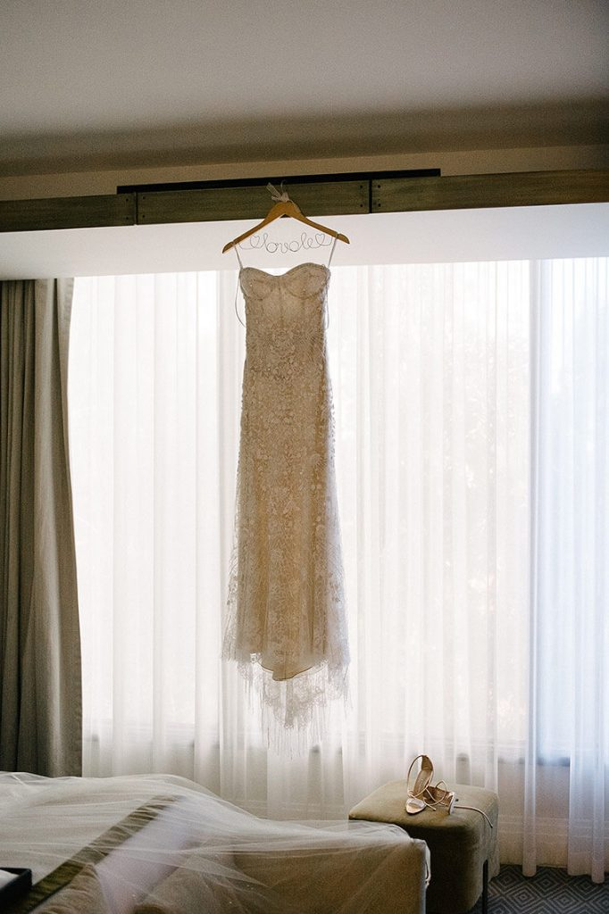 bridal gown hangs in front of window at london west hollywood