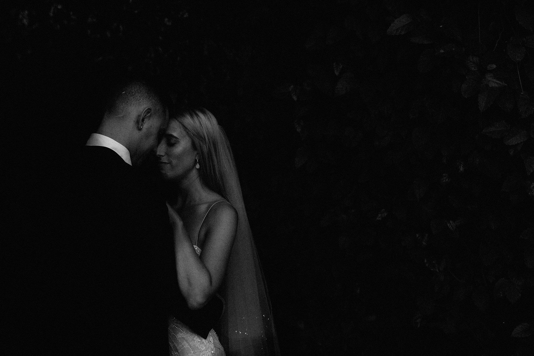bride and groom pose under dark awning at hollywood hotel