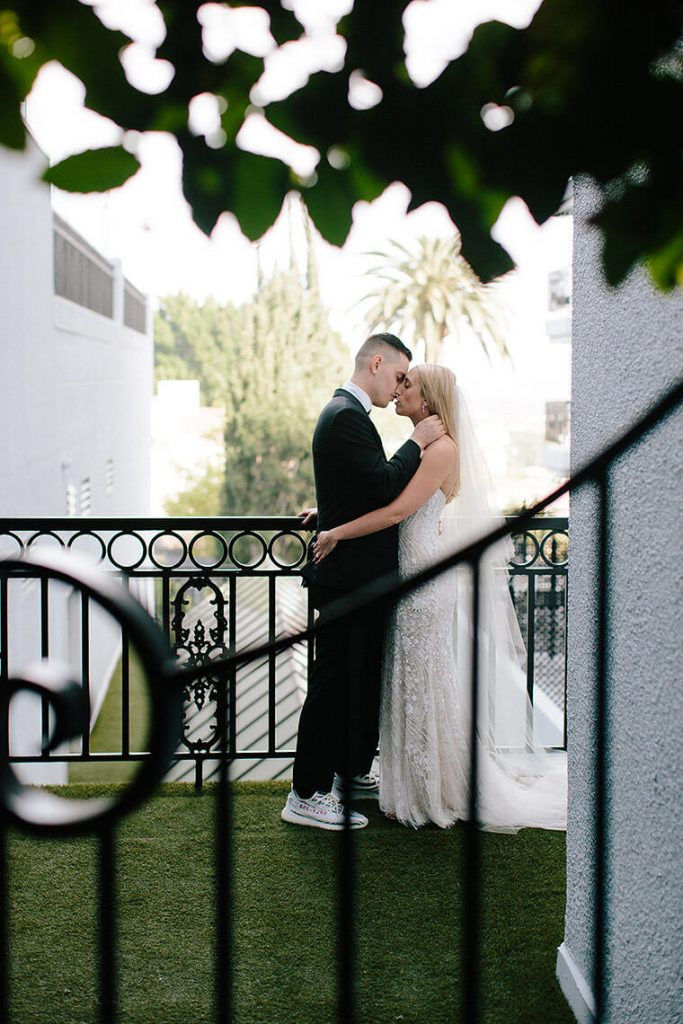 bride and groom kiss on rooftop of london west hollywood before wedding