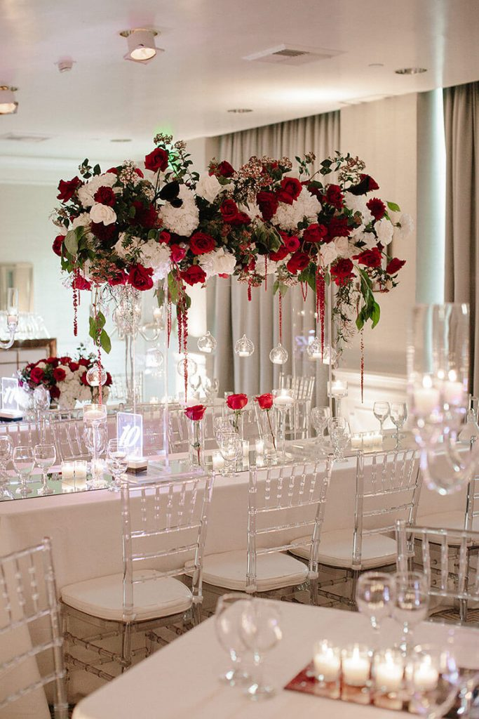 red and white roses in hurricane vase for london west hollywood wedding reception