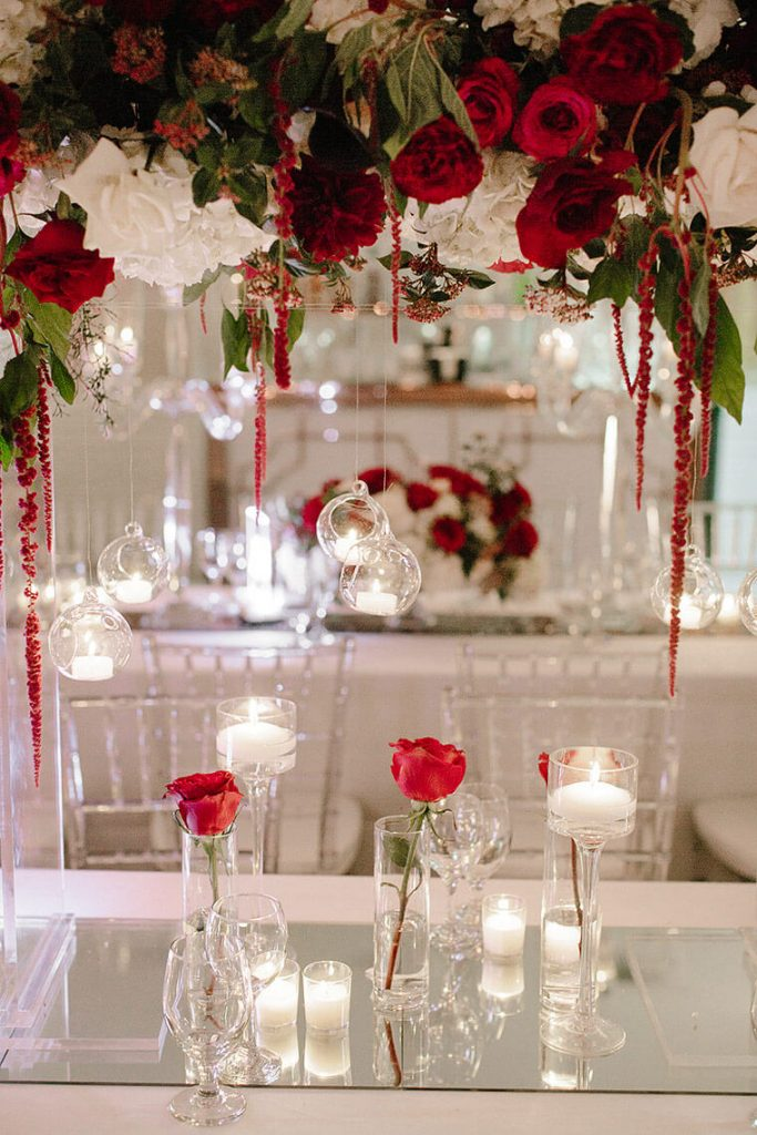 red and white flowers on luxury tables at london west hollywood wedding