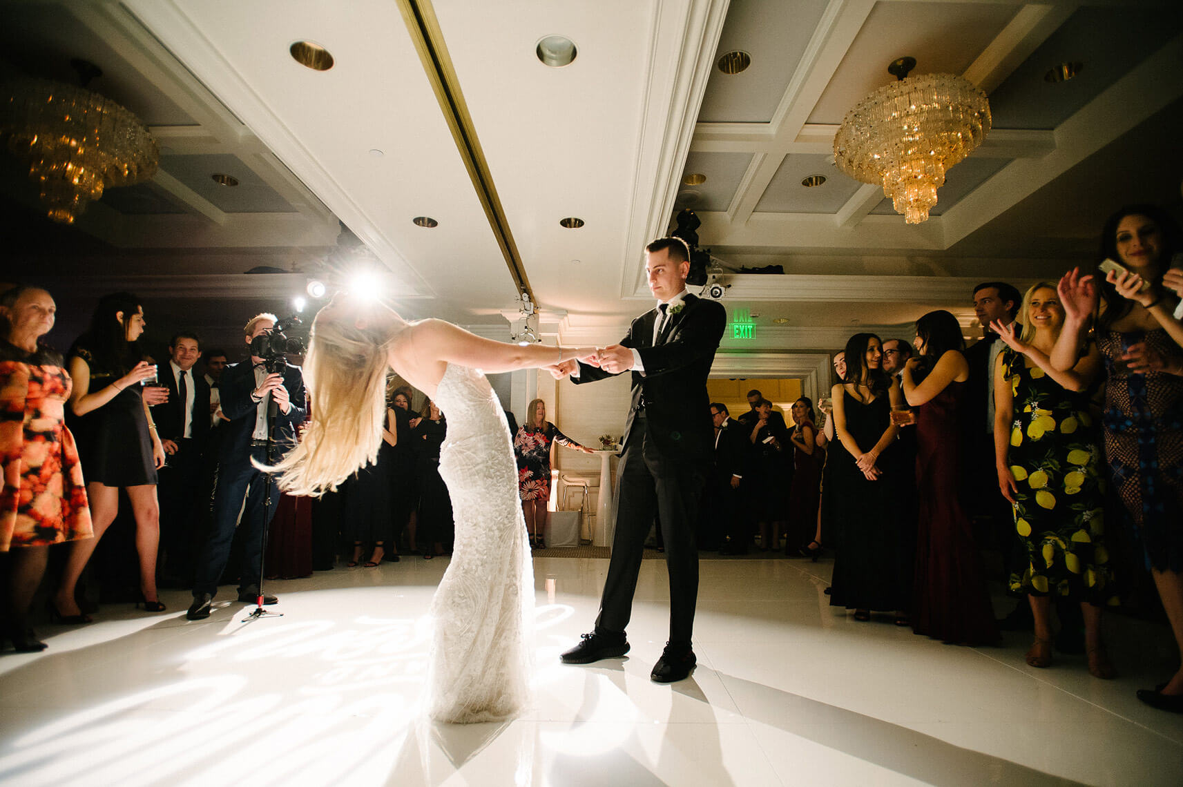 bride throws her head back during first dance with groom at hollywood wedding