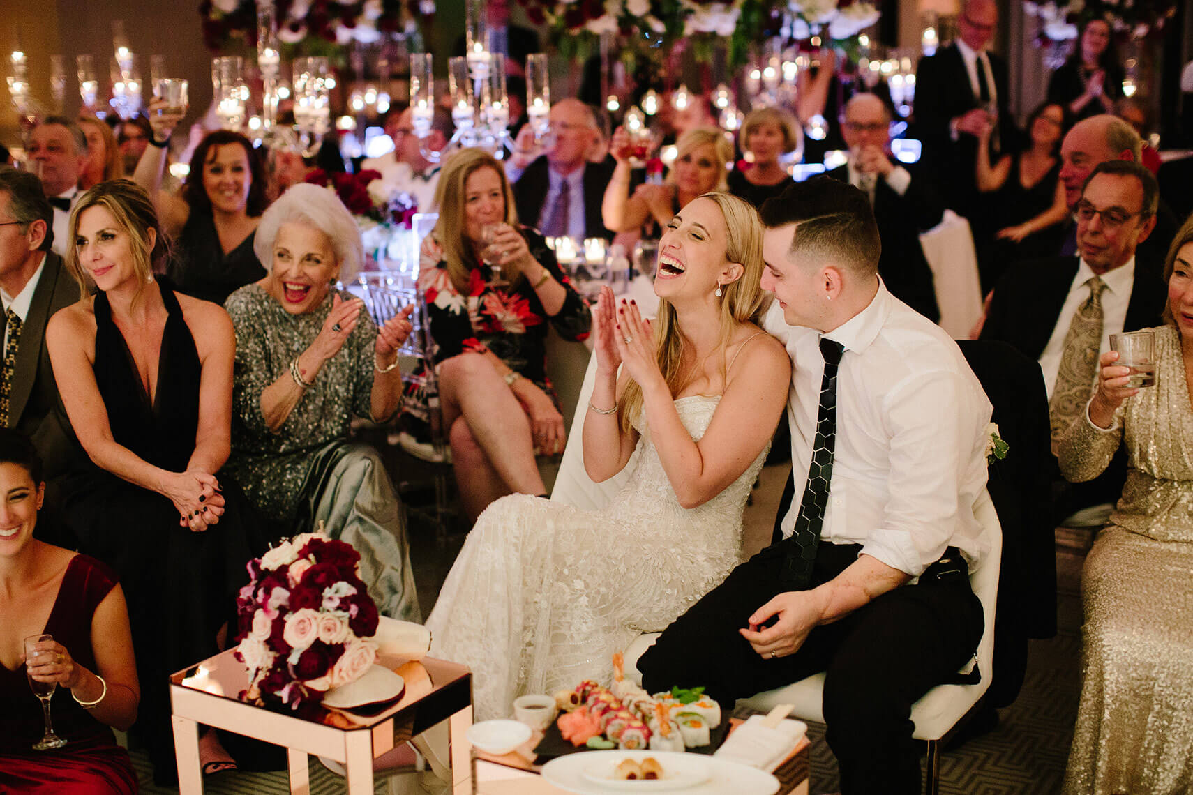bride and groom laugh at toasts during their west hollywood wedding reception