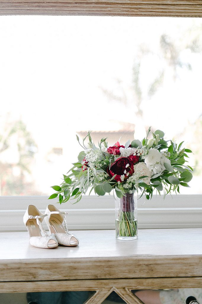 bride shoes and bouquet near window la jolla wedding