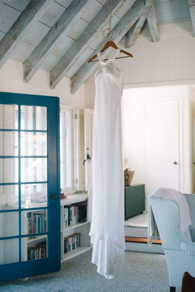 susan neville gown hanging in home st malo beach wedding