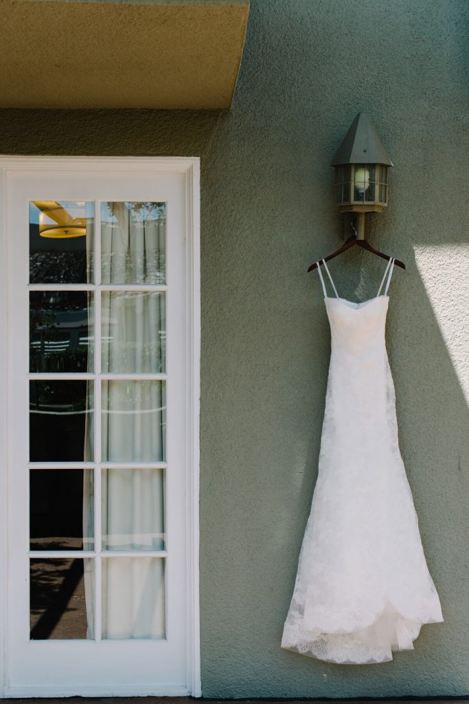 strapless vera wang dress hanging lauberge hotel