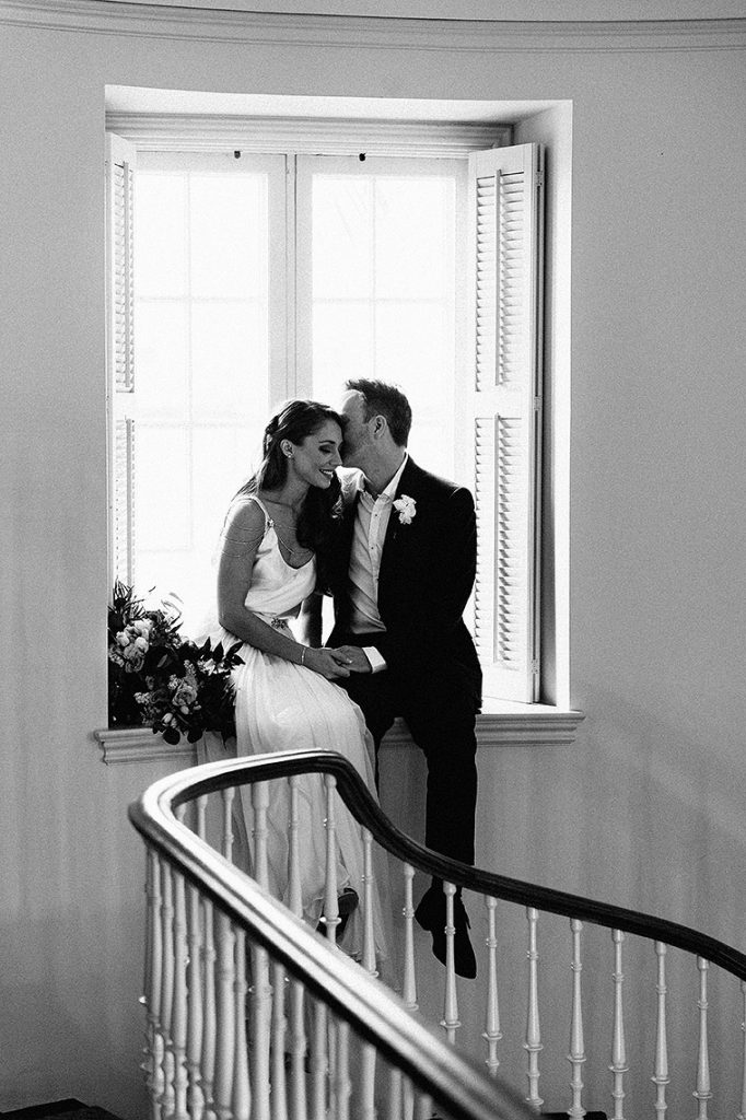 bride and groom sit on window sill staircase darlington house