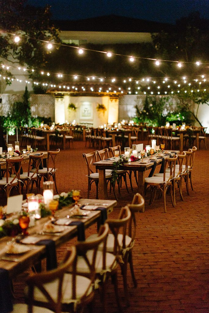 long wooden tables under market lights for darlington house la jolla wedding