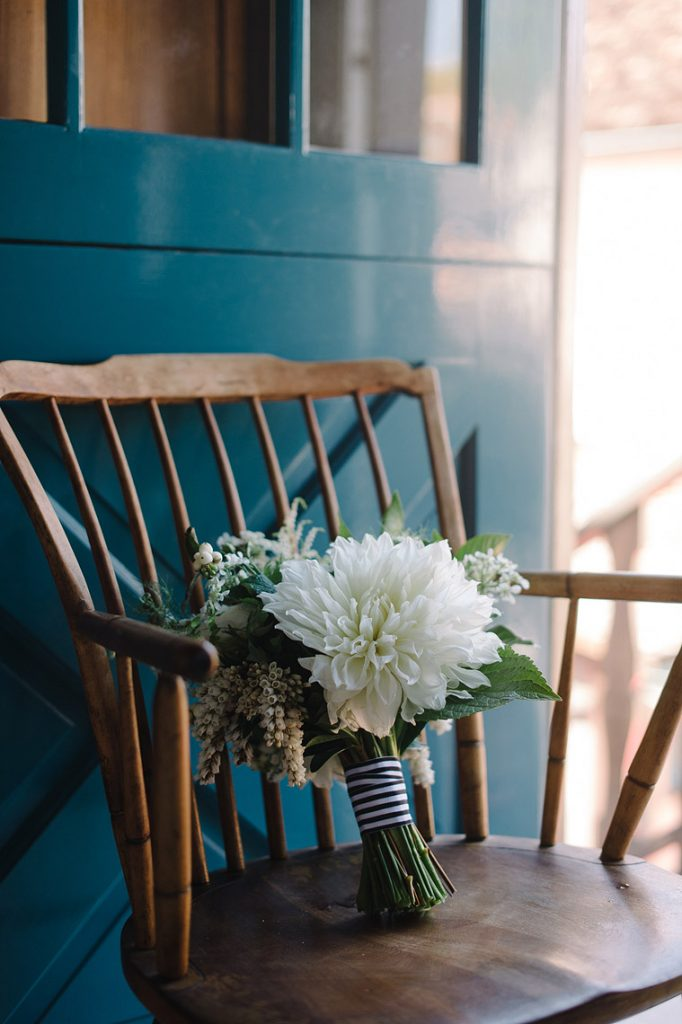 bridal bouquet with white dahlias on chair st malo