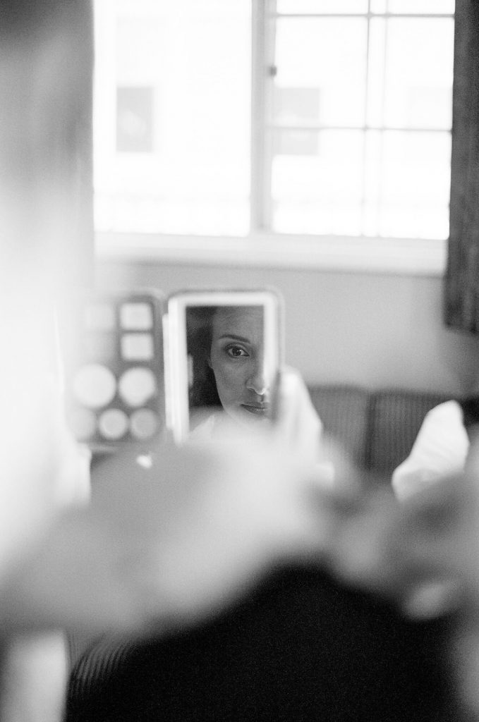 brides eye reflecting in makeup mirror