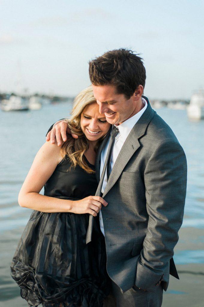 couple embracing newport harbor yacht club engagement