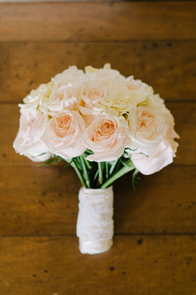 white and light orange bridal bouquet