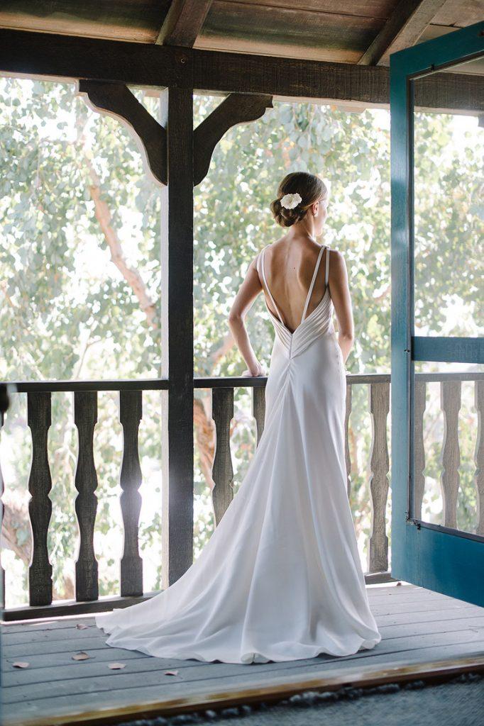 bride posing in susan neville gown st malo beach wedding