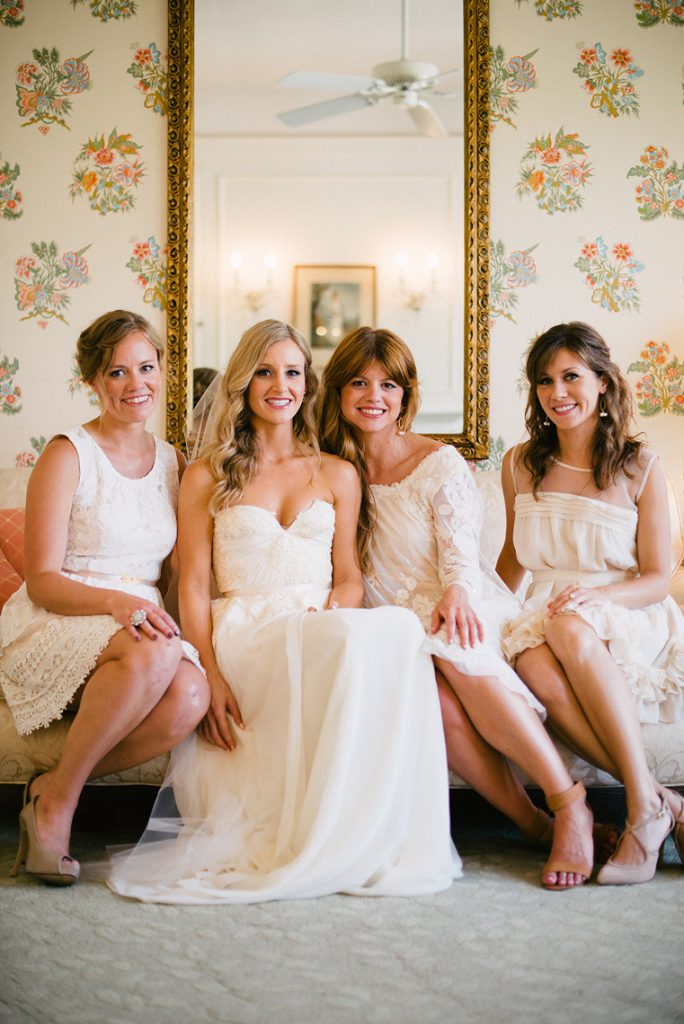 bride and bridesmaids sit on chair bridal suite darlington house wedding