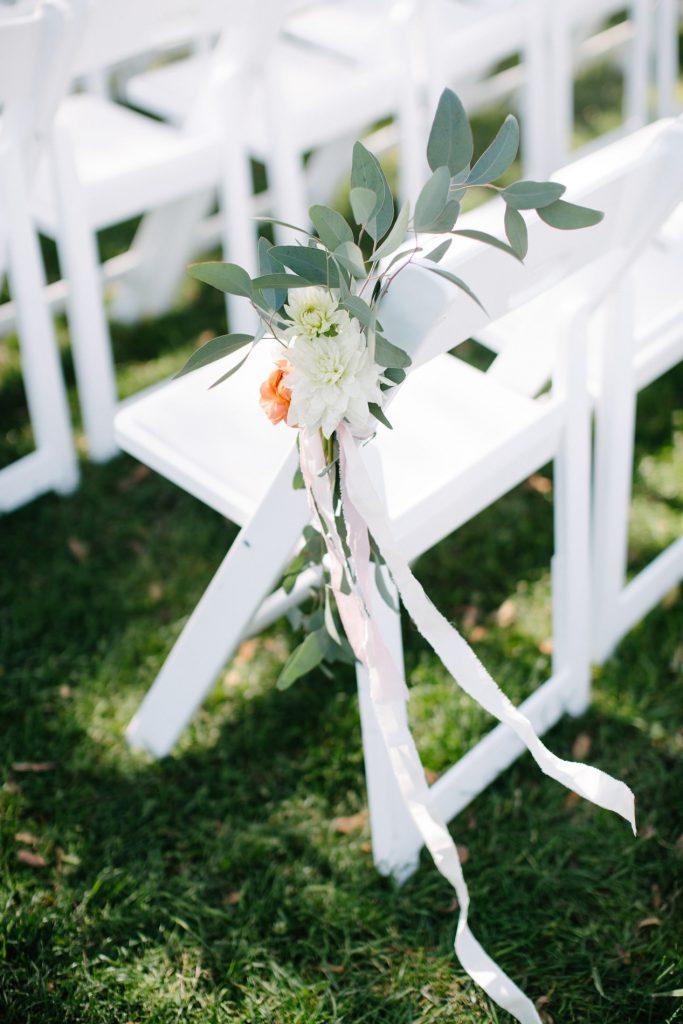 flower and ribbon tied to chair inn at rancho santa fe wedding