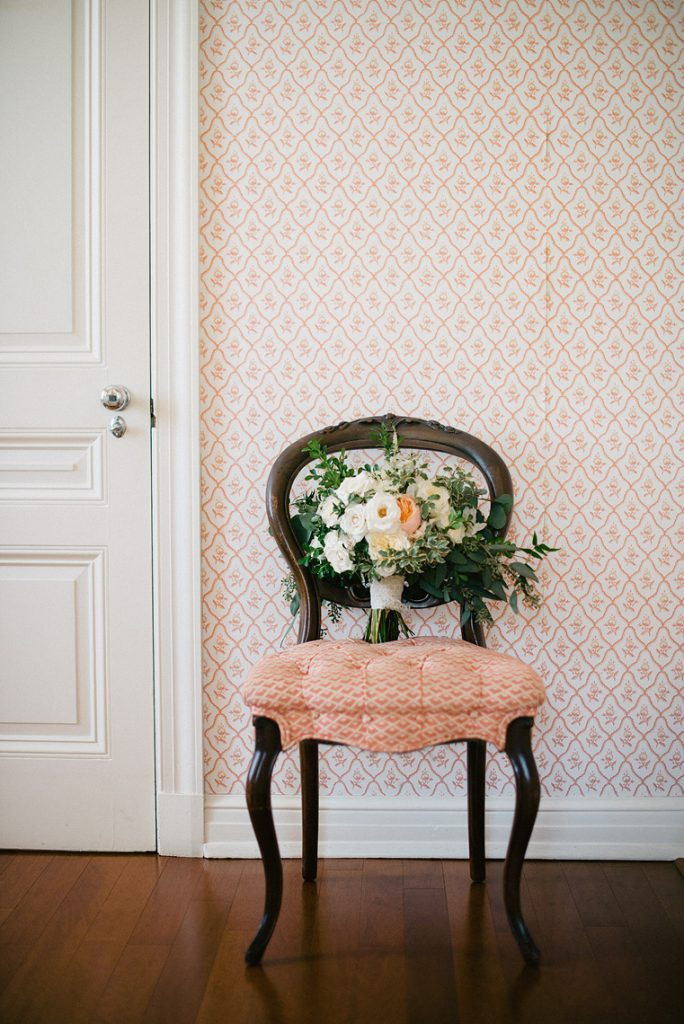 bouquet sitting on antique chair bridal suite darlington house wedding