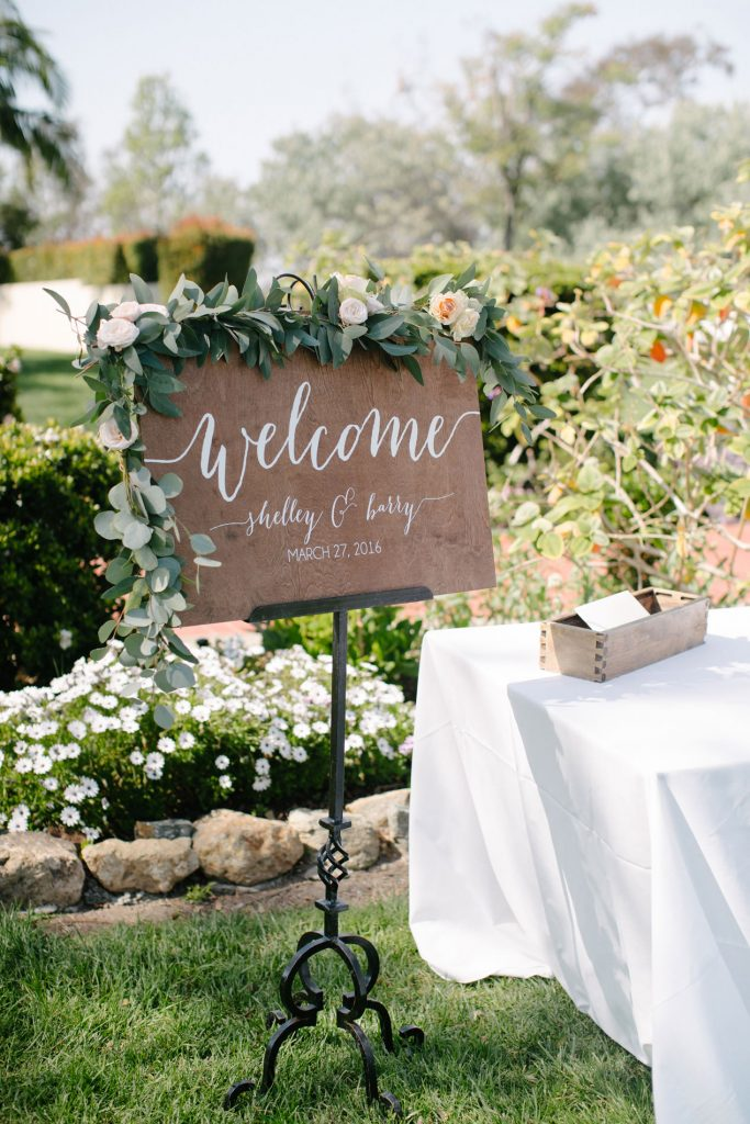 welcome sign with flowers inn at rancho santa fe wedding
